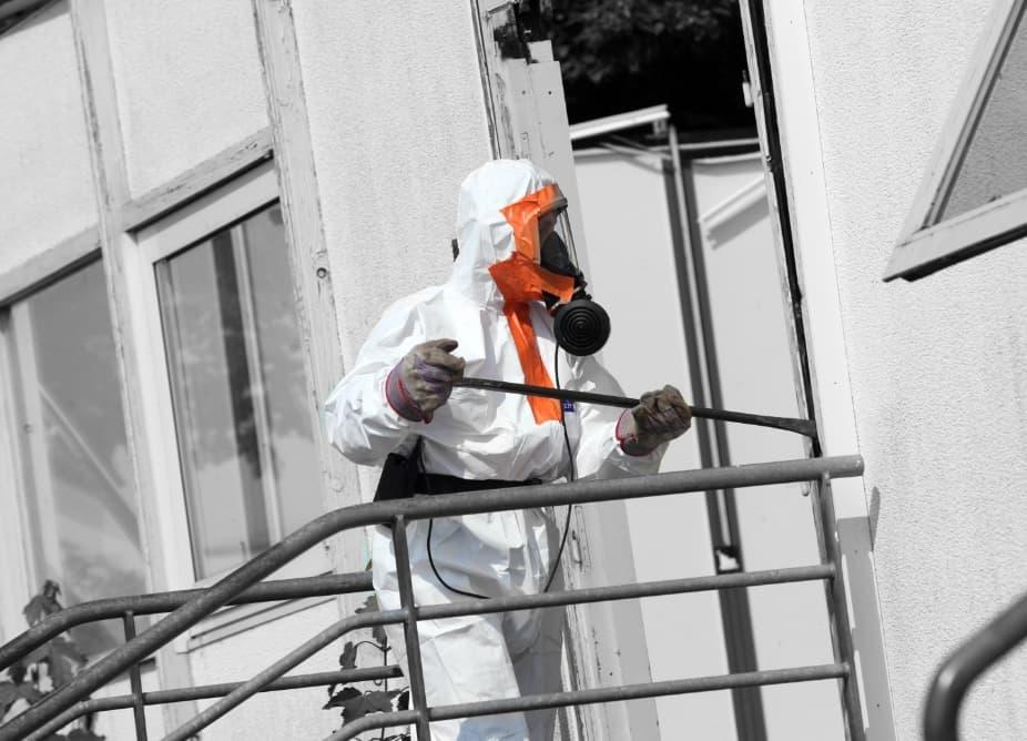 Team undergoing Asbestos removal