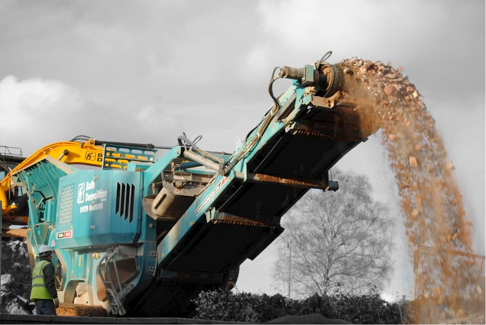 Concrete crushing machine from Bath Demolition Bristol, following the demolition our team follow through with concrete recycling
